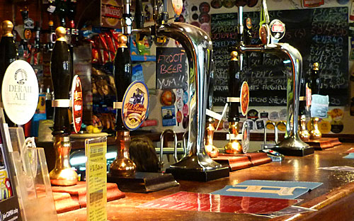 Along the bar at the Criterion - lots of ale pumps, signs and tempting offerings
