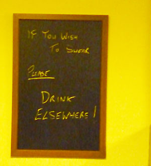 """If you wish to swear, please drink elsewhere!"" A chalkboard in the Ale House"