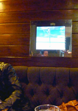 TV set into the wall at the Beehive